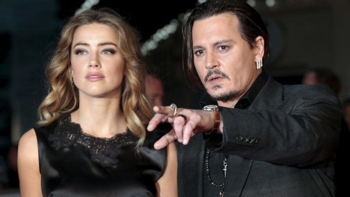 "Cast member Johnny Depp and his actress wife Amber Heard arrive for the premiere of the British film ""Black Mass"" in London, Britain October 11, 2015. REUTERS/Suzanne Plunkett/Files"