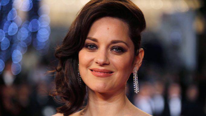 "FILE PHOTO --  Cast member Marion Cotillard poses on the red carpet as they arrive for the screening of the film ""Juste la fin du monde"" (It s Only the End of the World) in competition at the 69th Cannes Film Festival in Cannes, France, May 19, 2016.  REUTERS/Regis Duvignau/File Photo"