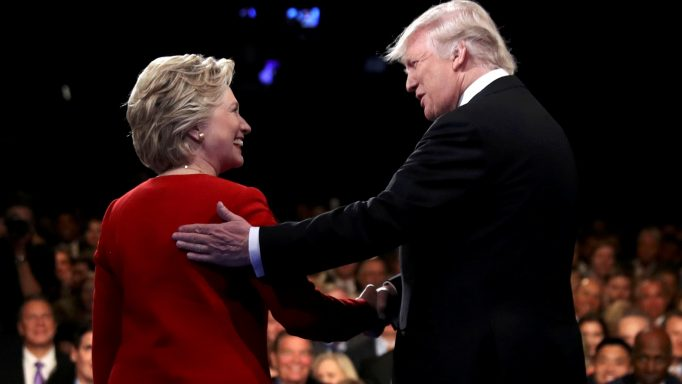Donald Trump shakes hands with Hillary Clinton. REUTERS/Joe Raedle/Pool
