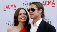 "Cast member Brad Pitt and actress Angelina Jolie pose at the premiere of ""The Tree of Life"" at LACMA in Los Angeles May 24, 2011. REUTERS/Mario Anzuoni/File Photo"