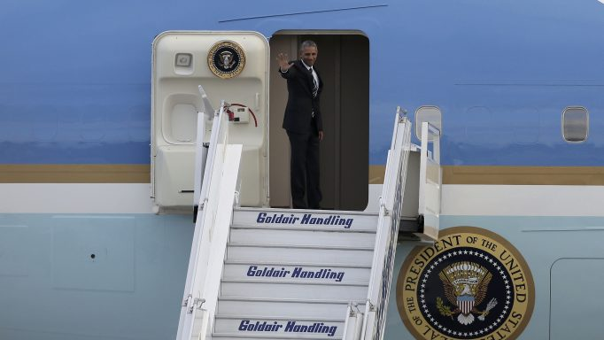 U.S. President Obama waves as he boards Air Force One to depart for travel to Germany, at the Eleftherios Venizelos International airport in Athens