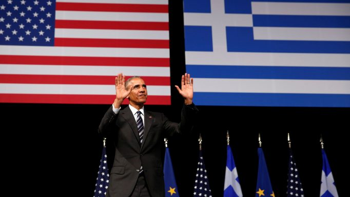U.S. President Barack Obama acknowledges applause after delivering a speech at the Stavros Niarchos Foundation Cultural Center in Athens
