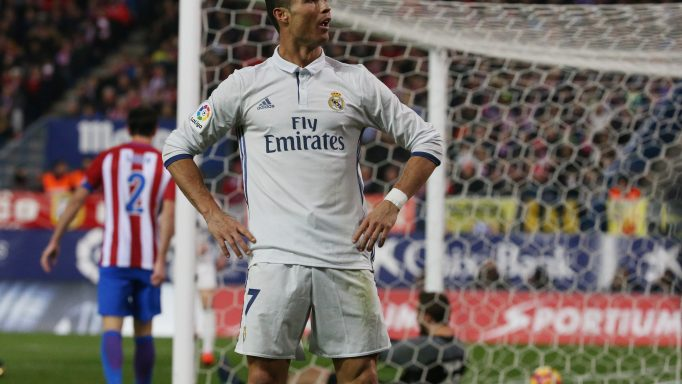 Real Madrid's Cristiano Ronaldo celebrates scoring their third goal and his to complete his hat trick